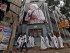 Nuns belonging to the global Missionaries of Charity, walk past a large banner of Mother Teresa ahead of her canonisation ceremony, in Kolkata
