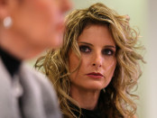 Summer Zervos listens as her attorney Gloria Allred speaks during a news conference announcing the filing of a lawsuit against President-elect Donald Trump in  Los Angeles, California
