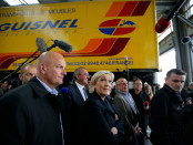 Marine Le Pen, French National Front (FN) party candidate for 2017 presidential election, walks past a truck during a campaign visit in Dol-de-Bretagne