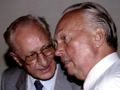 FILE PHOTO: Former East German Defence Minister Heinz Kessler (L) chats with former East German deputy Defence Minister Fritz Streletz in Berlin