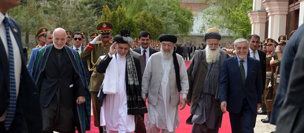 Former Afghan President Karzai, Afghan President Ghani, Afghan warlord Hekmatyar, former Jihadi leader Abdul Rabb Rasool Sayyaf and Afghanistan Chief Executive Abdullah walk to attend a ceremony in Kabul